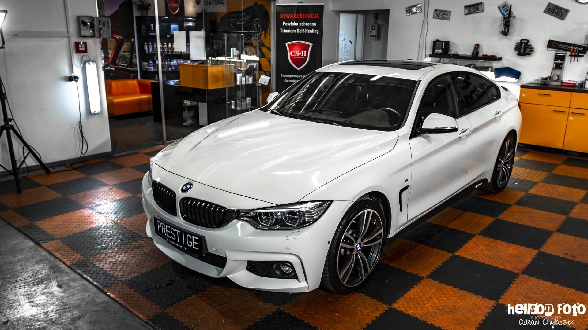 Białe BMW serii 4 lewy bok