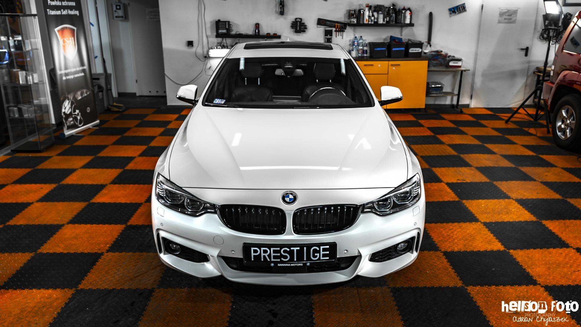 Białe BMW serii 4 maska